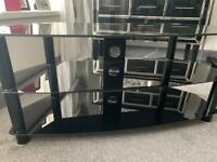 Immaculate black glass tv table