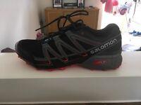 Professional running shoes. Salomon speed cross vario.