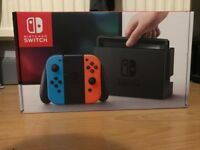 Nintendo switch console + super Mario Odyssey Game