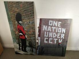Banksy canvas prints. £10 each, £17 for both