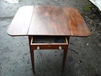 Small dark oak folding table with a drawer