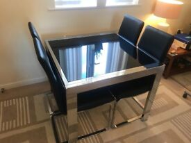Chrome and black glass extending dining table