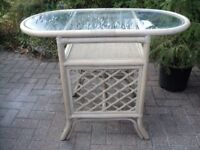 an oval bamboo and glass table