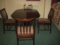 Stag Minstrel dining room table and four matching chairs