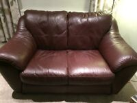 2 seater brown leather couch and foot stool