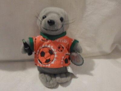Coca Cola Plus Beanie Seal in Soccer Shirt