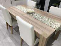 Next extendable wooden dining table with 3 cream leather chairs