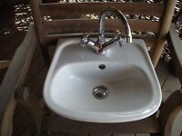 Small white sink with tap