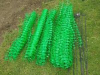 Green mesh fence and poles