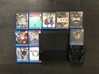 Hardly used PS4 with loads of games