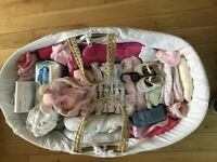 Moses basket of girls baby clothes 0-3