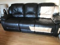 Dark brown leather couch and chair