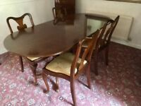 Mahogany dining table and four chairs with embossed gold upholstery