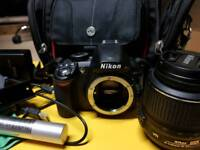 Nikon D3100 + 18-55 VR lense + pc lead, battery, charger + bag, cloth & spray, 8gb card
