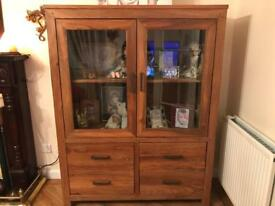 Solid wood unit with glass doors