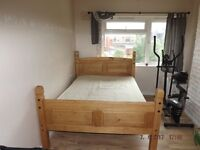 Corona solid pine double bed with mattress. Near New. Immaculate, used less than 10 times.