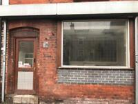 Shop with potential flat in leigh