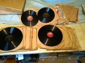 "Old vinyl records. About 100. Mix of 12"" and 10"". Most in brown paper sleeves. Decca, HMV etc"