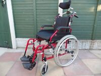 lightweight aluminium wheelchair with a 'super head' head rest