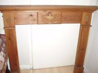 adecorative cottage style firesurround pine having central adam style urn swags circa 1930s