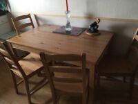 Kitchen table and four chairs all in knotted pine first class condition