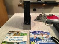 Black Wii console and 2 games
