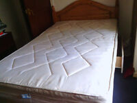 Queen size bed with lovely wooden headboard excellent condition 60