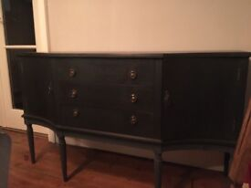 Side board cabinet with brass pulls painted in dark blue / graphite