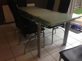Glass dining table with chairs- extendable