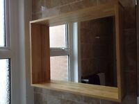 Mirror with shelving surround