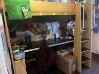Bunk bed with a huge desk