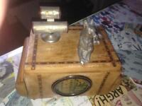 Musical cigarette box with white metal dog and perpetual calendar