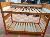 single wooden bunk bed frame with two drawers