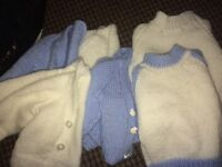 Hand knitted cardis and jumpers