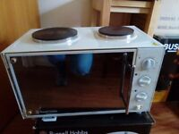 Mini-electric oven with 2-ring hob and microwave available