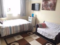 Morden/Merton Park: Double bedroom in a specious family home in SW19 area just behind Morden Station