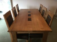 Solid oak table and 6 chairs ( Sterling Furniture)