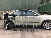 Golf clubs. Some hardly used. Assorted makes. Includes bag