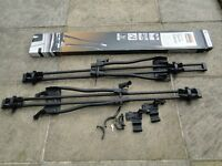 Two Halfords Advanced cycle/bike carriers for roof bars lockable. Hardly used