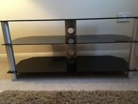 TV STAND with 3 black glass shelves and silver supports