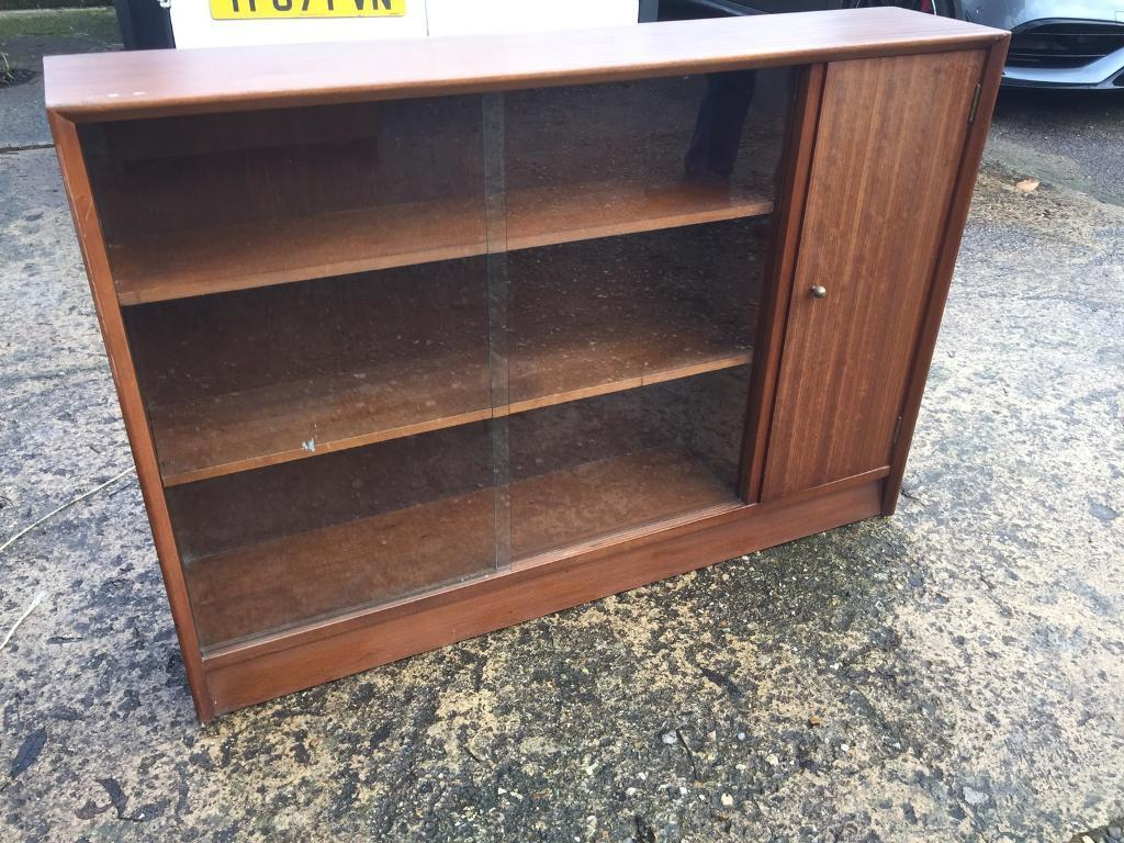 Retro wooden shelf unit with glass sliding doors, delivery available