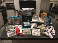 Wii U bundle including games, board, 3 controllers, amibo and accessories
