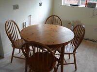 Used circular pine kitchen table and 4 matching chairs