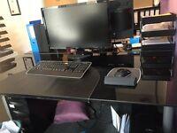 2 black glass office desks