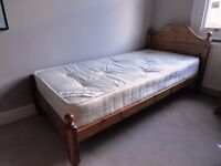 Solid pine single bed with 'as new' orthopaedic mattress.