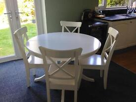 White extending IKEA table and chairs
