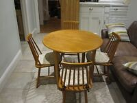 Kitchen table and 4 chairs. Well made solid real wood. Table 90cm in diameter