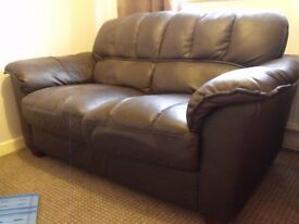 Dark brown faux leather sofa in good condition