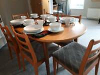 Wood oval dining table and 6 chairs