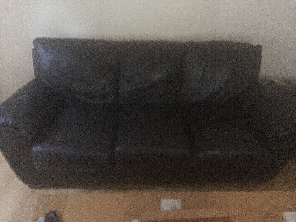 Brown leather sofas and foot stool